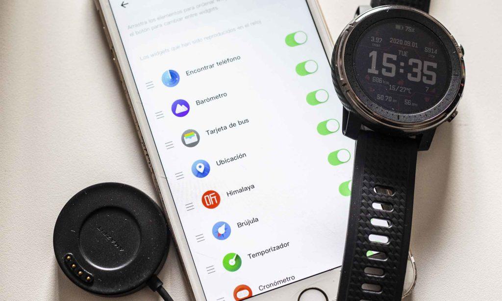 Reloj, cargador y aplicación