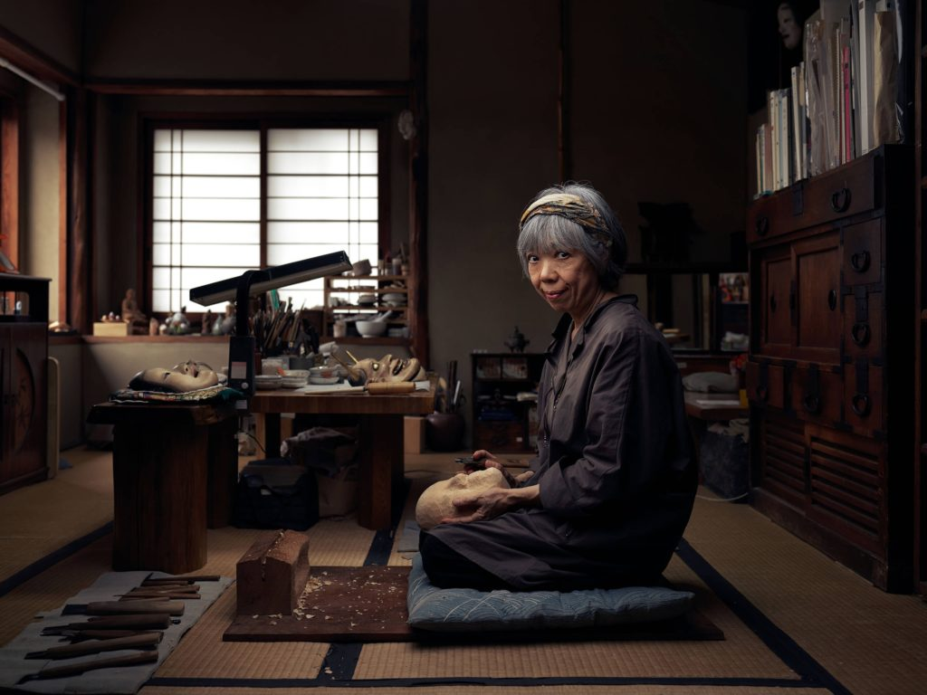 Noh mask maker Mitsue Nakamura works in Kyoto where she has her own school teaching the art of mask making.